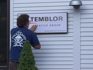 New Temblor sign being hung